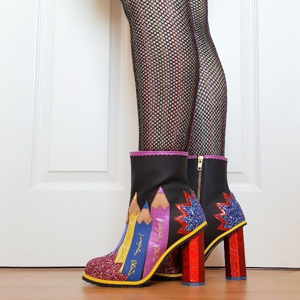 close up of legs and feet wearing pencil ankle boots with concept heel