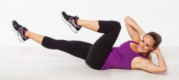 Lift upper body to the left and right while lying on your back and touch your knees