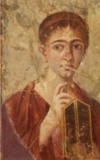 pittura pompeiana: donna con tavolette per scrivere