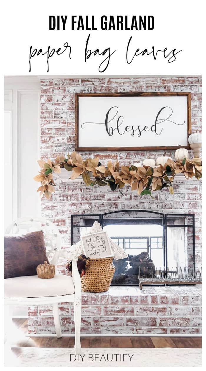 Fall decorated mantel with paper leaves garland and neutral pumpkins