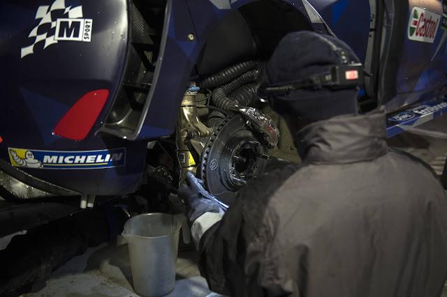 Rally Mechanic Checking Brakes