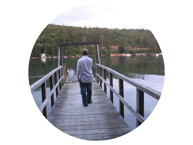 Taking a walk on a dock overlooking a lake in Maine to reflect and meditate