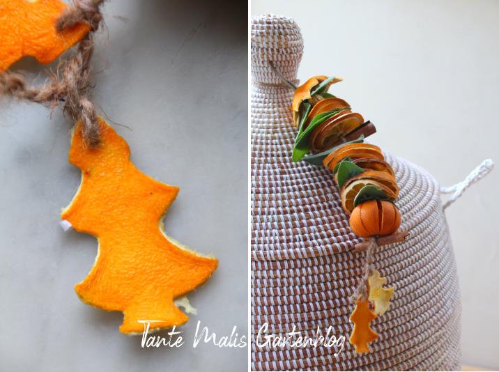 Weihnachtsgirlande aus Orangen und Kräutern