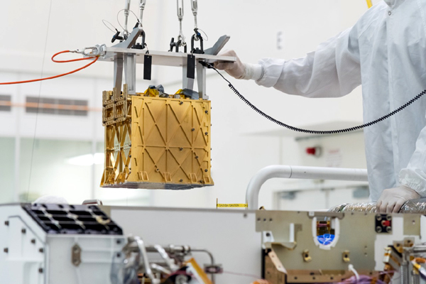 At NASA's Jet Propulsion Laboratory near Pasadena, California, the MOXIE instrument is about to be installed inside the chassis of the Perseverance Mars rover.