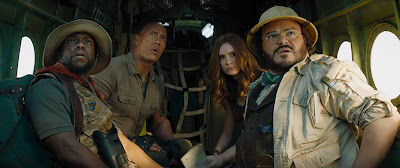 "Kevin Hart, Dwayne Johnson, Karen Gillan, and Jack Black star as Franklin Finbar, Dr. Smolder Bravestone, Ruby Roundhouse, and Professor Shelly Oberon in the 2019 sequel ""Jumanji: The Next Level."""