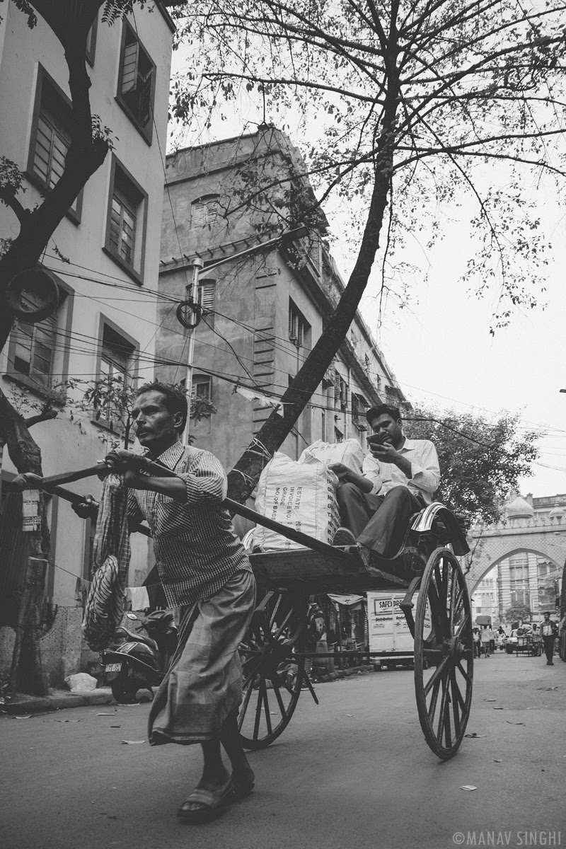 Hand Pulled Rickshaw (Hath Rickshaw) The Picture was taken at Bara Bazar, Kolkata.