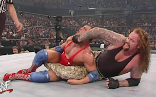 WWE / WWF Survivor Series 2000 - The Undertaker and his terrible snake skin pants challenged Kurt Angle for the WWF title