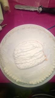 piping on a hamburger at a wilton decorating class