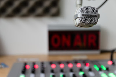 Radio studio with On Air sign and microphone