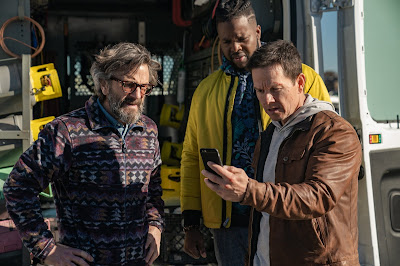"Photo: In Netflix's original film ""Spenser Confidential (2020), Spenser (Mark Wahlberg) and Hawk (Winston Duke) meet up with journalist Wayne Cosgrove (Marc Maron) to look at the evidence about Wonderland."