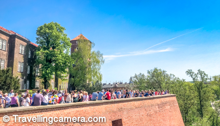There are various places in Wawel Castle where you can sit and enjoy magnificent views of the place. In the middle of the castle, there are huge green area but you are not allowed to walk on the grass, but can use seating arrangements around this lawn. Above photograph shows the exterior wall of Wawel Castle and Vistual River is visible on the other side from this wall. All these folks are here to see Vistual river and click the photographs there.