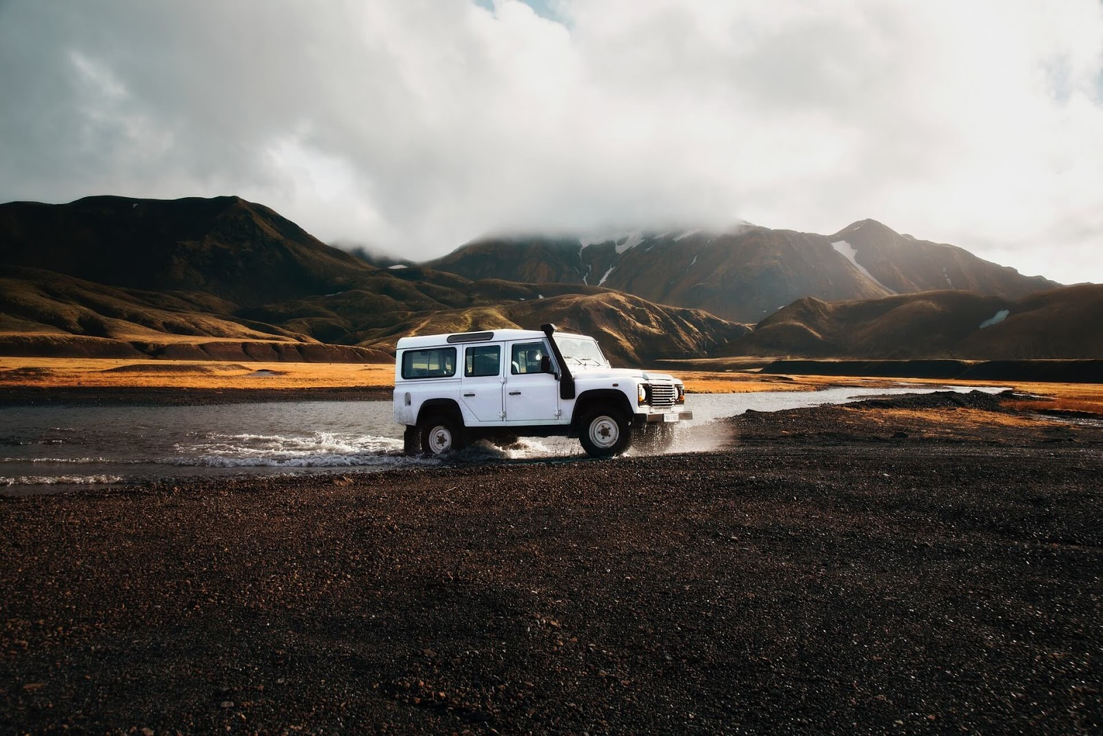 White landrover jeeps, off-roading , crossed a river bed
