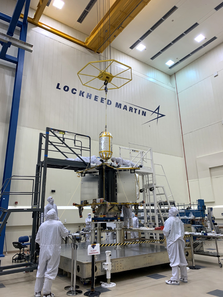 At the Lockheed Martin facility in Denver, Colorado, technicians are about to install the oxygen propellant tank inside NASA's Lucy spacecraft.