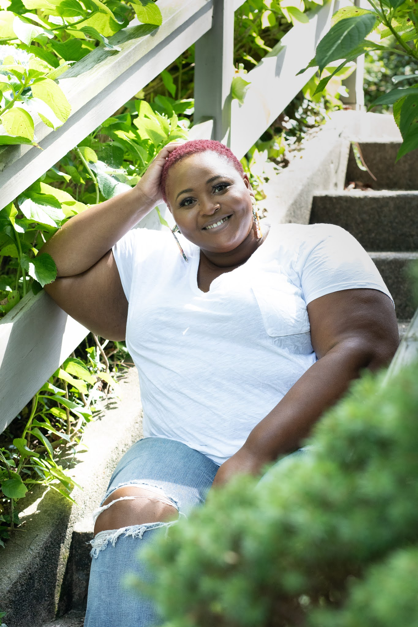 Plus size woman white shirt and jeans