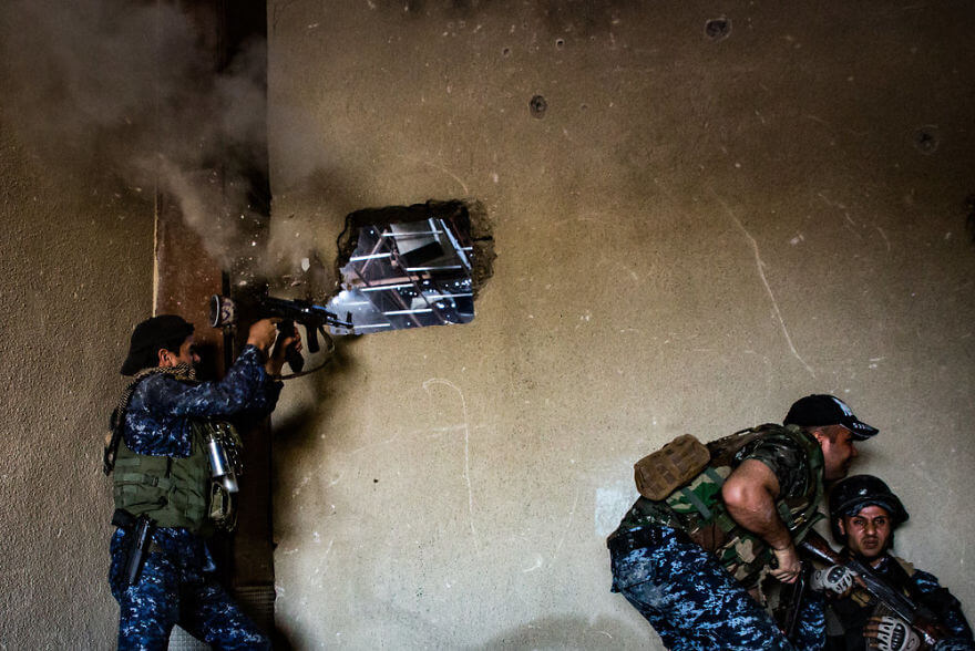 Powerful Heart-Breaking Pictures Of The Battle Of Mosul - An Islamic State bullet punches through the wall next to a Federal Policeman