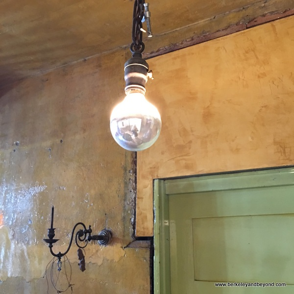 naked light bulb at The David Ireland House in San Francisco, California