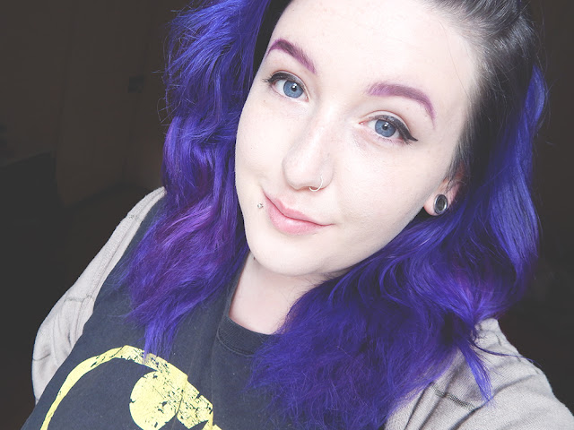 Girl with purple hair and purple eyebrows