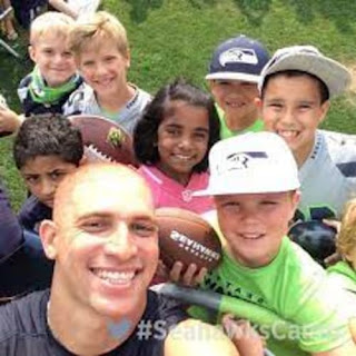 Jimmy Graham Posing With His Fans