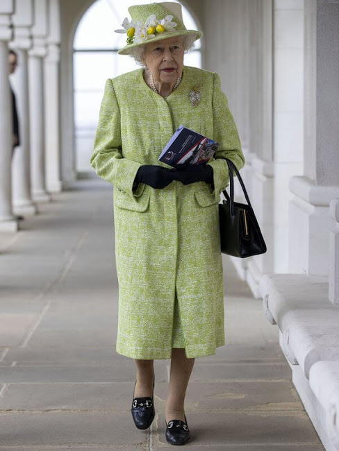 Queen Elizabeth, wearing a lime green coat and the Wattle brooch presented to her on first tour of Australia in 1954