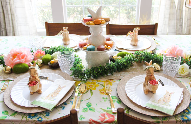 Love this Easter table idea filled with flowers and bunnies! #eastertable #easterbrunch #easterdecor #eastercenterpiece