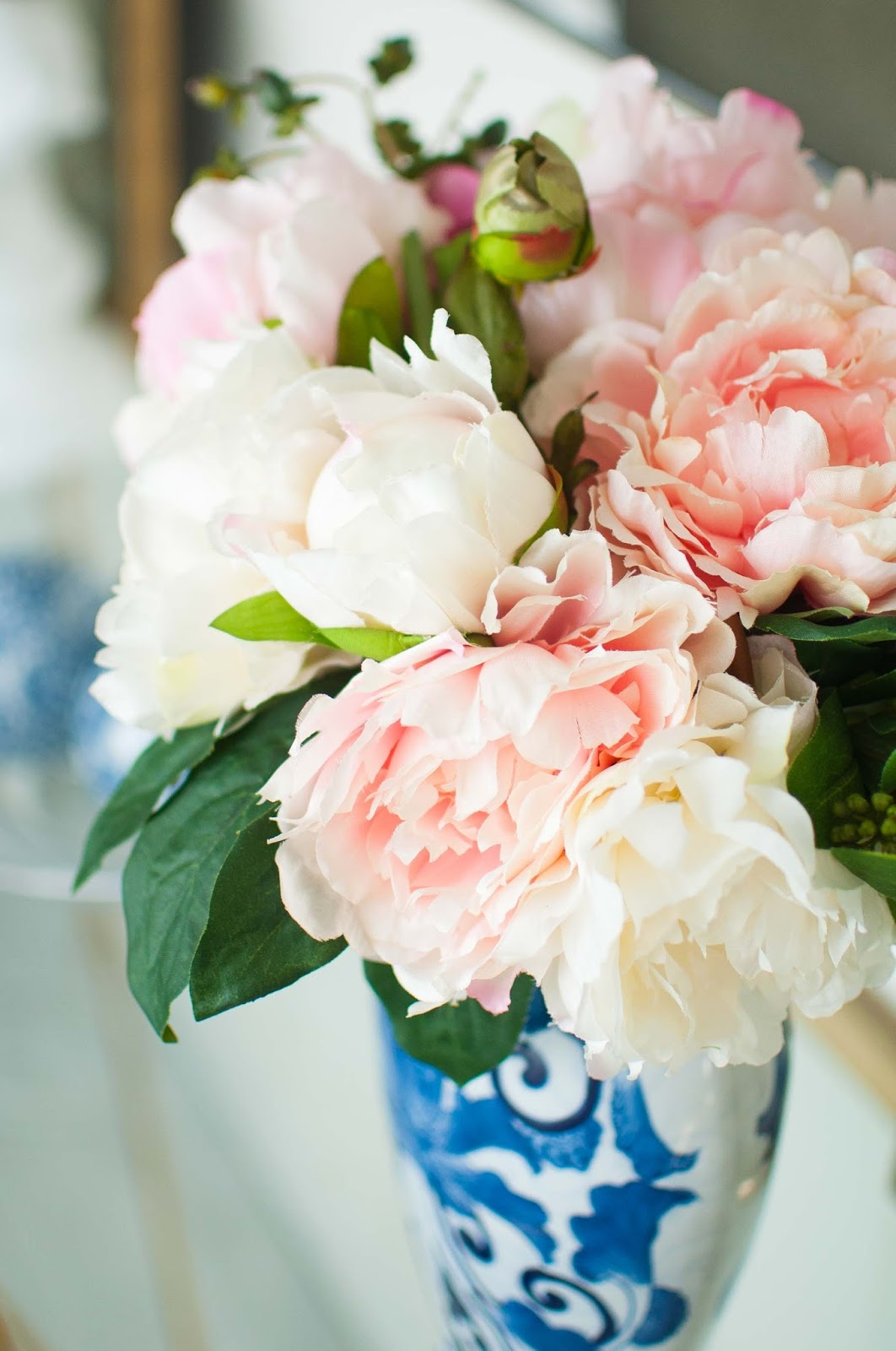Beautiful fake or faux florals in a foyer.