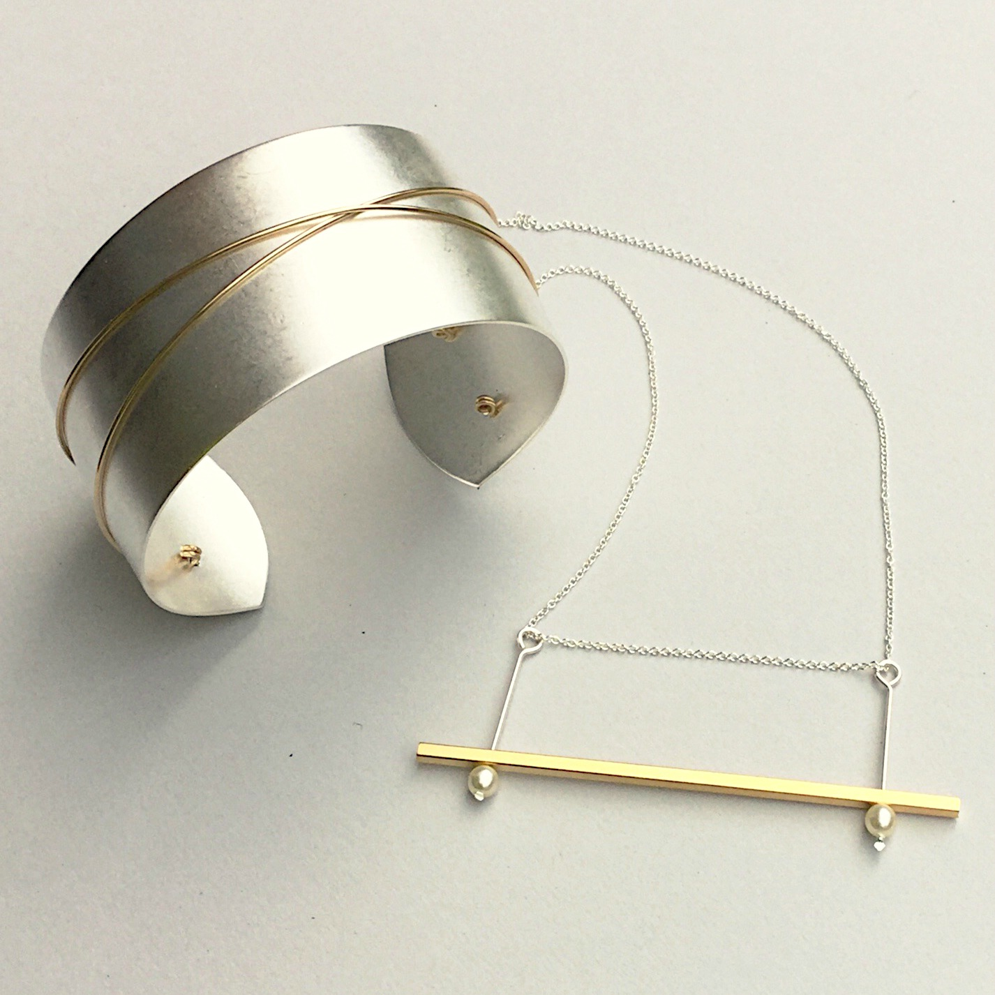 Artifacts how it 39 s made modern and minimal mixed metal for Minimal art jewelry