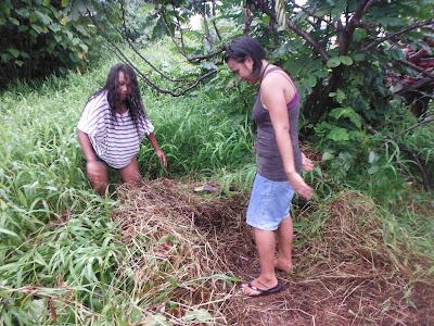 Natasha and April pulling grass