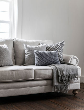 Beige sofa filled with pillows