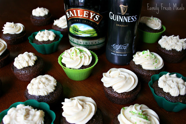 Guinness Chocolate Cupcakes with Baileys Cream Cheese Frosting laid out on a table