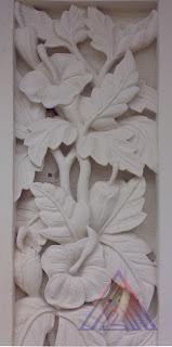 Relief batu alam paras jogja motif bunga sepatu