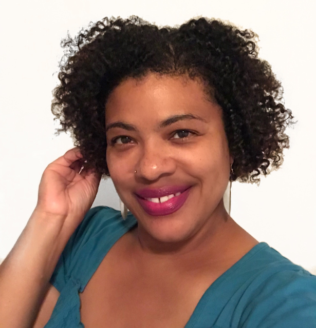 a woman with natural curly hair