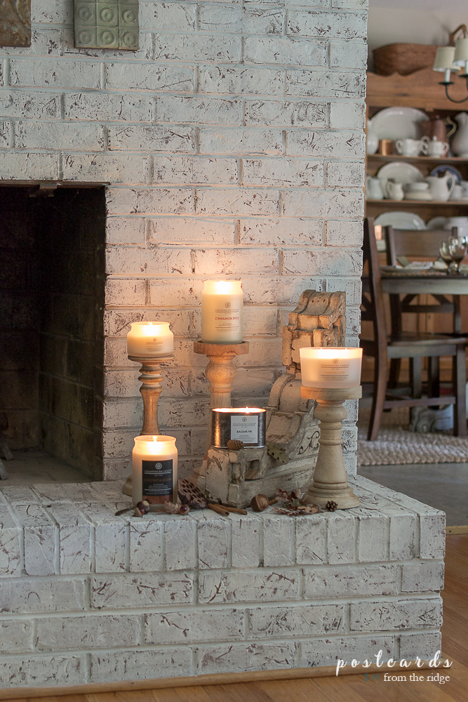 Chesapeake Bay Candles on a brick fireplace hearth