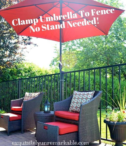 Sitting area around pool with umbrella clamped to fence