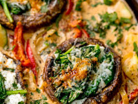 Tuscan Style Stuffed Mushrooms in Creamy Sun Dried Tomato Sauce
