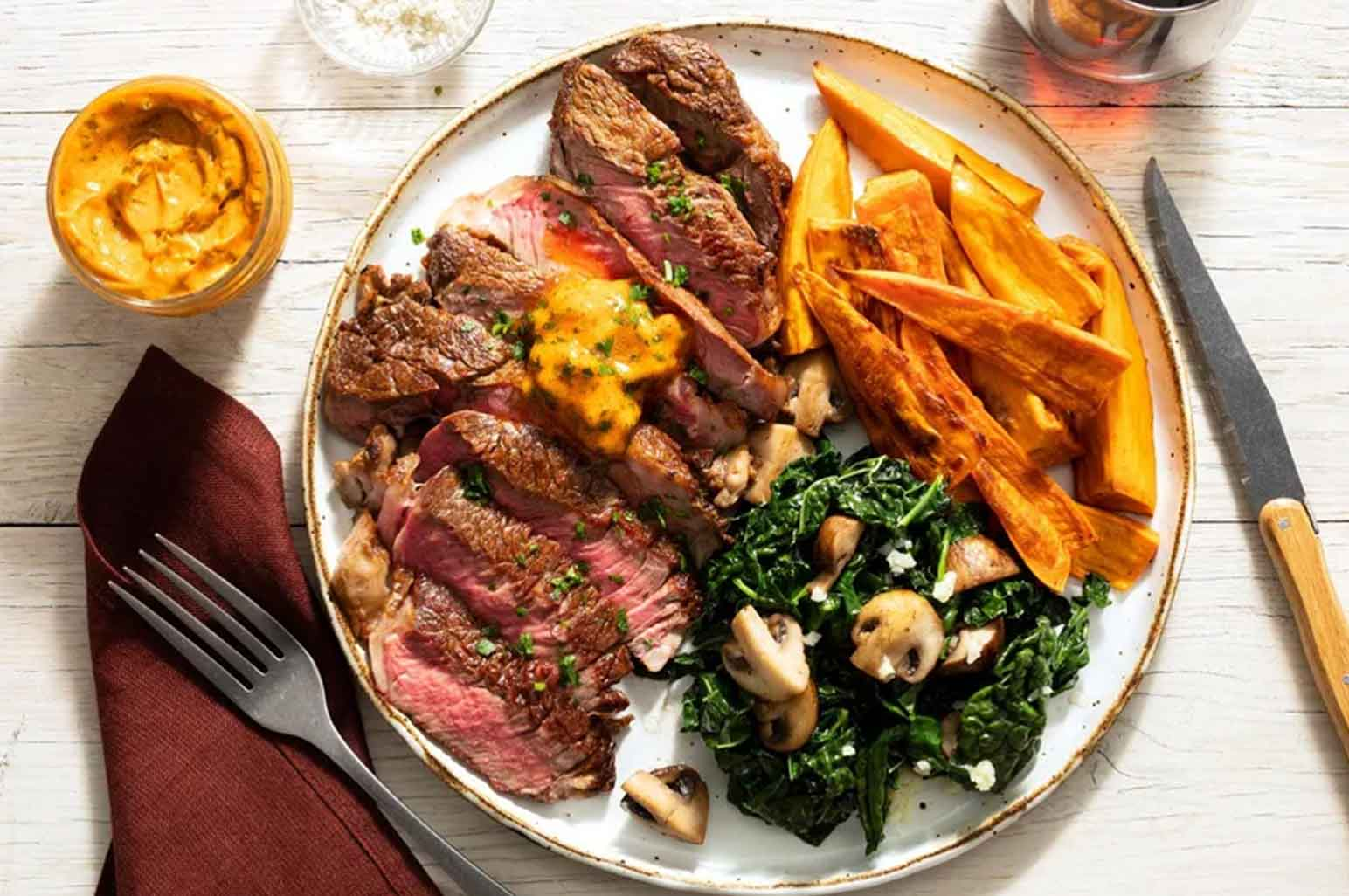 Black Angus Rib-Eye Steaks With Sweet Potato Frites, Kale & Mushrooms Recipe
