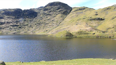 Easedale Tarn, with Tarn Crag as a backdrop, from the site of the Easedal Tarn tea hut, as featured in Walks Around Grasmere, a Jonathan Craig Guide