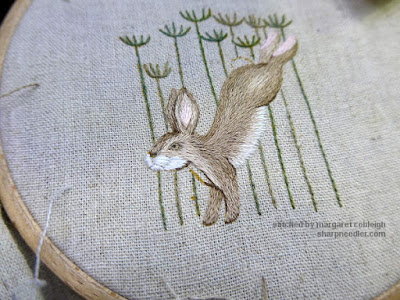 Jenny McWhinney's Queen Anne's Lace Travelling Work Station: Hare's long and short stitched body mostly complete