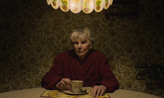 old woman sitting at a table