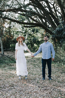 couple holding hands smiling