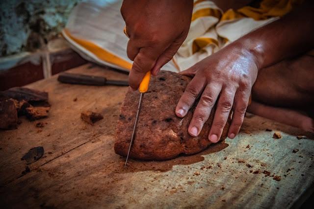 Cutting Poda Pitha for Lord Jagannath during Bahuda Jatra