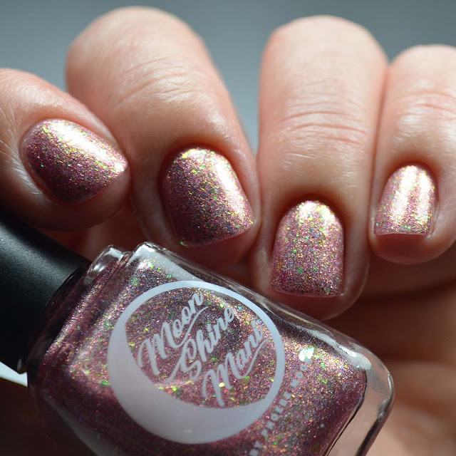 pink flakie nail polish swatch in low light