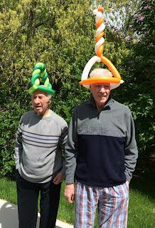 Older Gentlemen Sporting Cool Balloon Hats