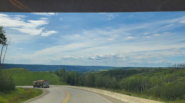 Log trucker ascending on highway 29