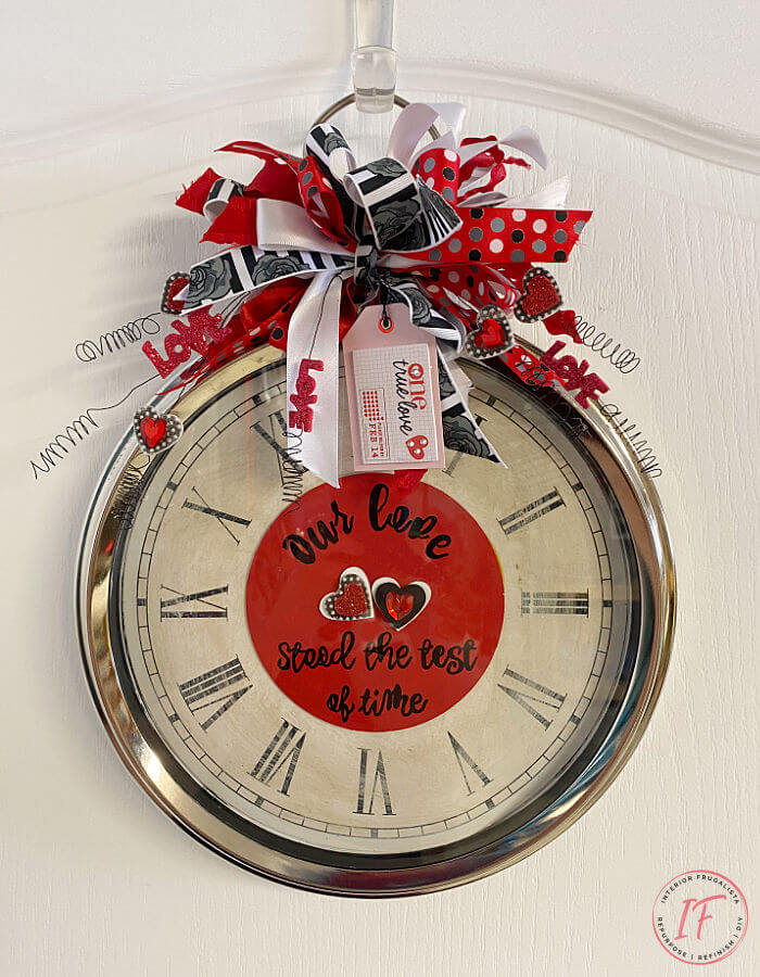 How to repurpose an old  wall clock and turn it into a whimsical DIY Valentines wreath. It's a fun, cheap, and unique door wreath idea.