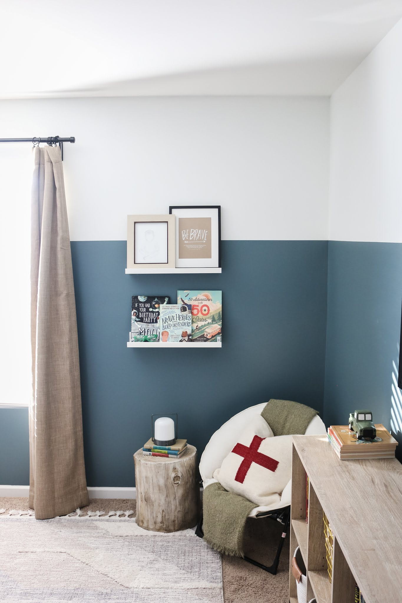 A classic modern boy's room with adventure elements, a subtle military vibe, and a modern take on red, white, and blue!