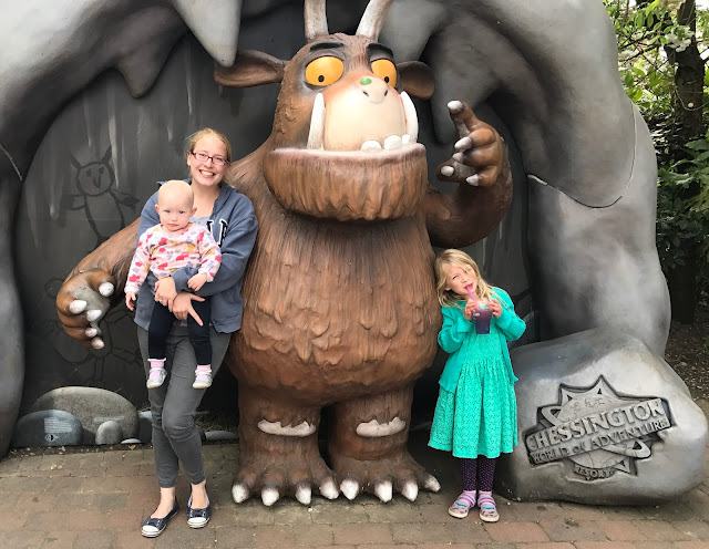 Me and my two daughters posing next to a large Gruffalo figure