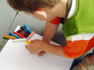 This is a boy drawing with colored pencils. Stock Photo credit: stonobis