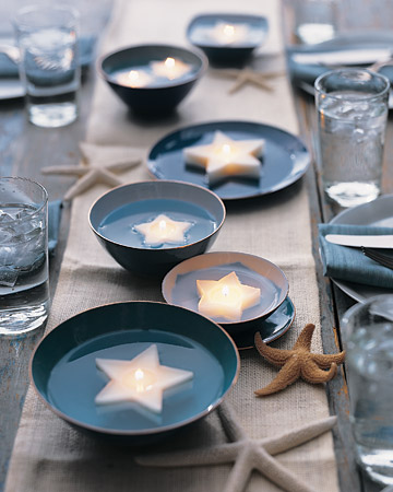 Star shaped candles in water are a fun way to light up any outside dinner party.