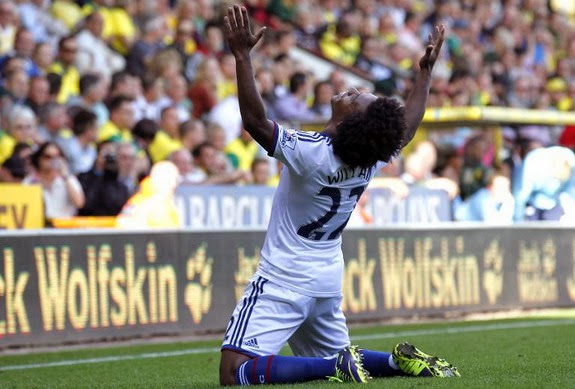 Chelsea midfielder Willian celebrates after scoring his team's third goal against Norwich