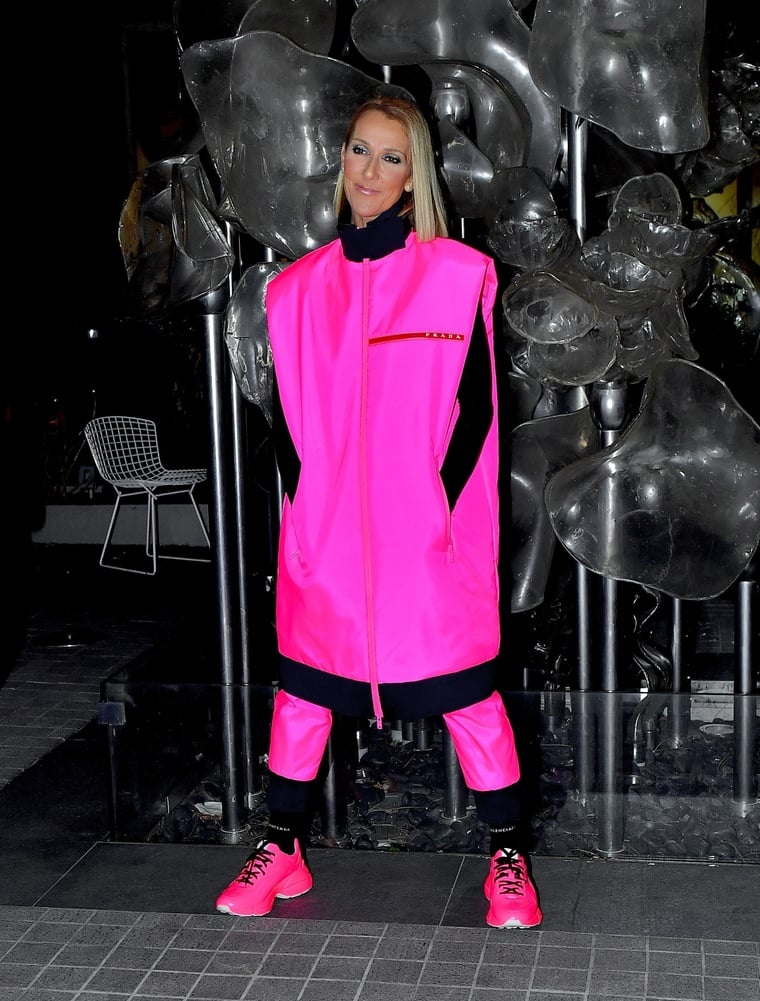 Celine Dion lights up the night in a head-to-toe neon pink Prada ensemble as she wraps her third Courage tour show at Barclays Center in NYC